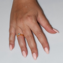 Handmade wedding ring with sterling silver gold plating and precious stones (zircon) IJ-010481-G worn in hand