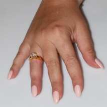 Handmade wedding ring with sterling silver gold plating and precious stones (zircon) IJ-010482-G worn in hand