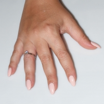 Handmade wedding ring with sterling silver platinum plating and precious stones (zircon) IJ-010486-S worn in hand