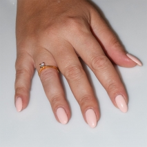 Handmade wedding ring with sterling silver gold plating and precious stones (zircon) IJ-010487-G worn in hand