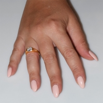 Handmade wedding ring with sterling silver gold plating and precious stones (zircon) IJ-010488-G worn in hand