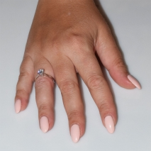 Handmade wedding ring with sterling silver platinum plating and precious stones (zircon) IJ-010489-S worn in hand